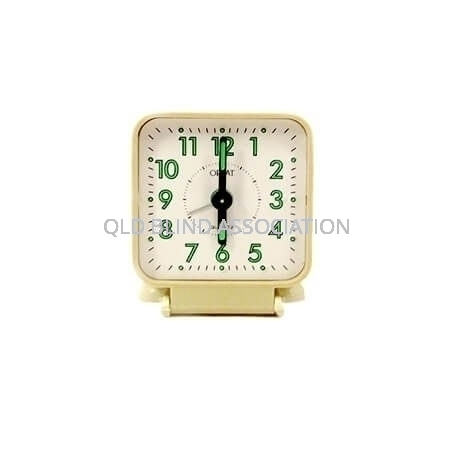 Travel Braille Clock with cream coloured face and outer casing and fluorescent green numbers